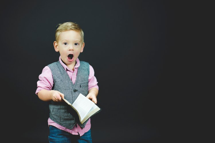 Boy reading - Photo by Ben White on Unsplash