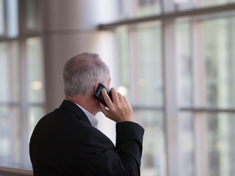 Businessman on phone - Photo by Jim Reardan on Unsplash