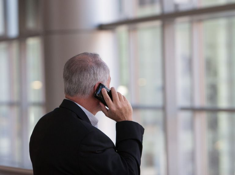 Businessman on phone - Photo by Jim Reardan on Unsplash